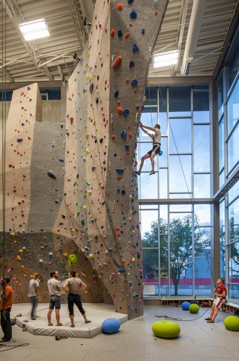 A climber ascends the north face of the Outdoor Adventures Center's Climbing Center west wall.
