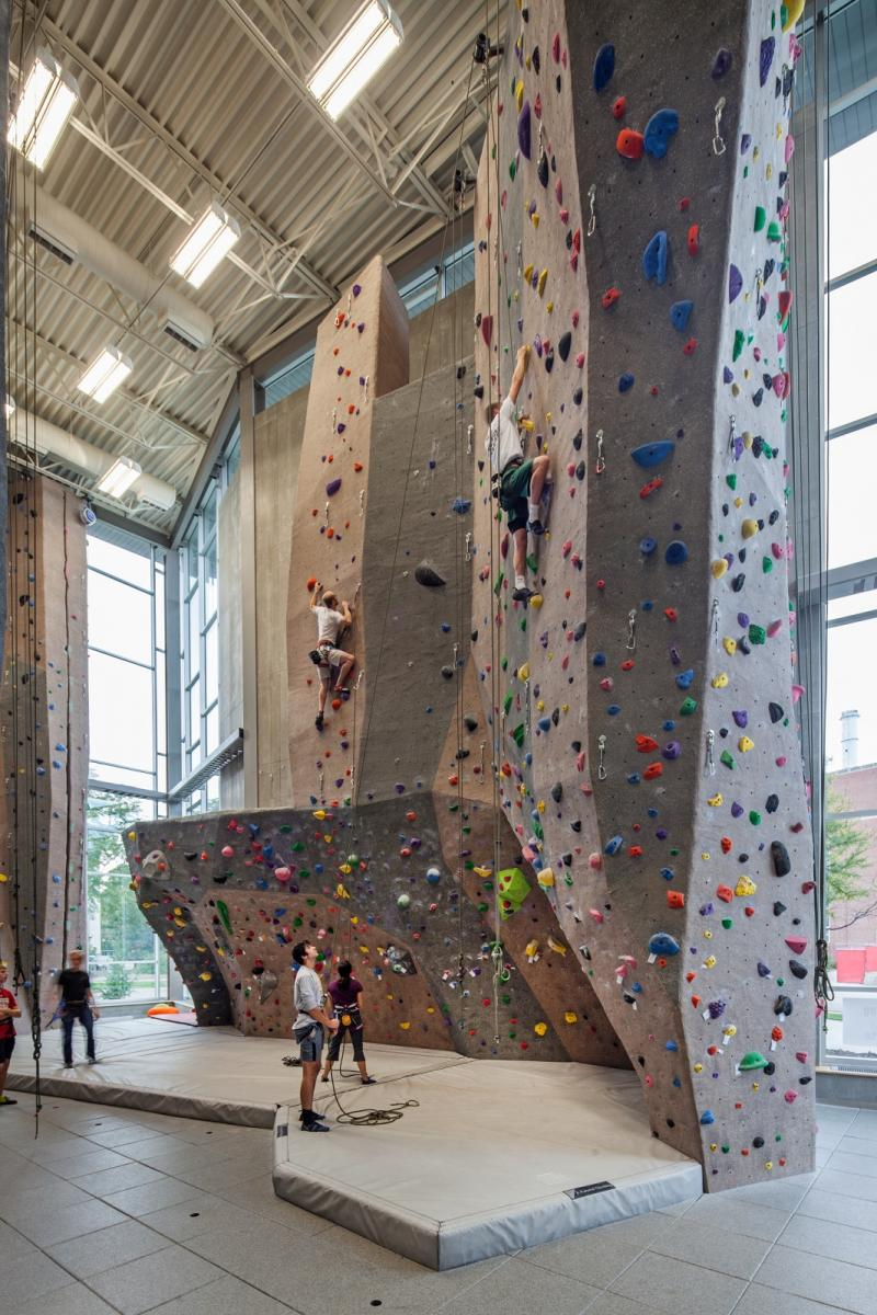 Climbers ascends the east face of the Outdoor Adventures Center's Climbing Center west wall.